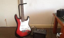 Full size electric guitar and Amp for sale. Great