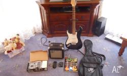 Im selling a left handed guitar that comes with an amp,