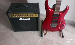 Electric guitar with tuner, leads, strap, marshall amp,