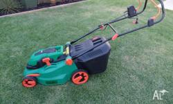 Small electric Lawn Mower. Less than 12 months old.