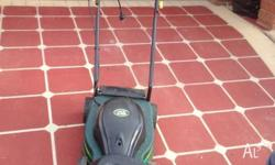 Electric lawn mower for sale, ideal for small areas.