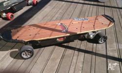 Remote controlled electric skateboard. Remote has two