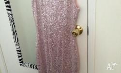 Elegant long pink sleeveless dress with paillettes,