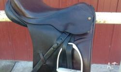 Lovely brown English leather 17 inch dressage saddle.