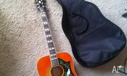 ABOUT THE GUITAR The classic Dove style acoustic first