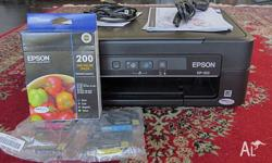 EPSON XP-100 PRINTER FOR SALE. BRAND NEW UNUSED. WITH 1