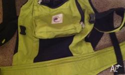Ergobaby performance baby carrier in apple green. in
