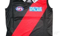 ESSENDON OFFICIAL YOUTH SLEEVELESS HOME GUERNSEY. -