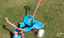 Pink and blue euro trike Good used condition Handle to
