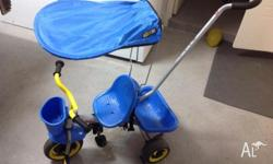 Good quality trike ($150 new) Child can be pushed in it