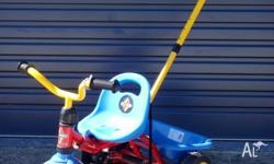 Eurotrike tricycle in blue, red and yellow. After