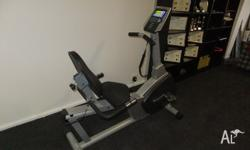 Recumbent electronic exercise bike. Heart rate monitor.
