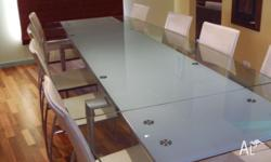 This modern glass dining table can be arranged as a 6