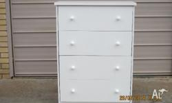 THIS GLOSSY WHITE 4 DRAWER TALLBOY ON METAL RUNNERS IS
