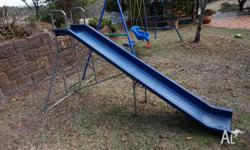 This extra long slide and swing set is in very good