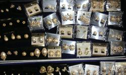 Lots of different ear rings broches necklaces belts