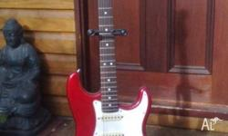 FENDER Stratocaster vintage electric guitar in Cherry