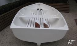 9 foot Fibreglass dinghy with timber oars in excellent