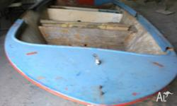 This boat hull needs rebuilding but is restorable. Good