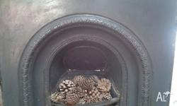 A fireplace fasica and firebox in good condition. In