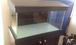 Fish tank for sale $475. Comes with Cabinet Filter and