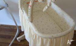 Fisher-Price Nursery Rocking Bassinet - like new,