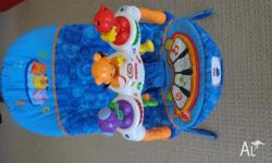 FISHER PRICE BOUNCER- ROCKS UP AND DOWN ALSO VIBRATES