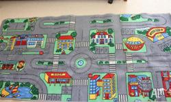 Mat of a township with shops, roads and parking. An