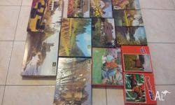 Large Assortment of puzzles. All In very good