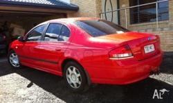 Ford falcon 4sp auto,red, Dec 2002 drives well , good