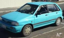 Fuel efficient 5-door ford Festiva (1993) - ideal for