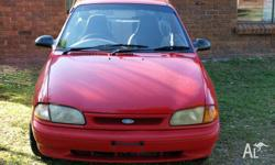 As traded and Sold AS IS, 1996 Ford Festiva Hatchback.