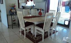 WE HAVE A FOSSEL STONE DINING TABLE FOR SALE. IT HAS 6