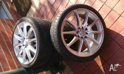 Four 17 inch Auscar rims with tyres, both rims and