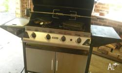 This is a red rock four burner LPG BBQ with side burner