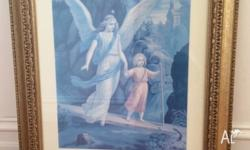 Framed print of angel with little girl. Print is faded,