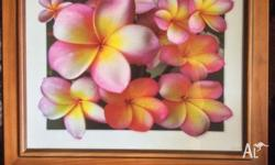 Great condition, wooden glass frame with frangipani