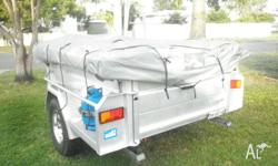6 x 4 ft camper trailer. Heavy duty canvas. 2 rooms -