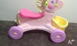 Fisher Price Brilliant Basics Roll-Along Musical Pony.