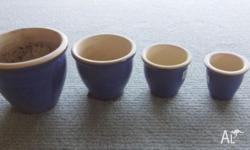 Garden ceramic blue pots set of 4.Only 1 was used the