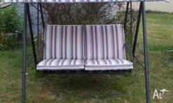 A 2 seat cushioned garden swing chair with sun shade.