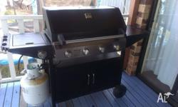 Gasmate brand BBQ. Metal hood. 4 burners under hood