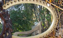 This is an oval mirror for $135 measuring 740 mm by 500