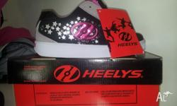 Brand new pair of girl's size 5 Heelys. These were a