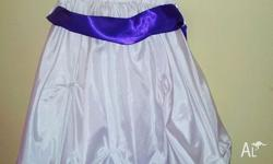 Gorgeous white dress with purple trim. Can be adjusted.