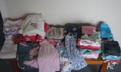 52 Items in excellent condition. Overalls, tops, pants,