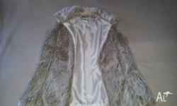 Girls Size 12 lined artificial fur vest. Never been