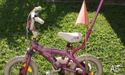 great condition girls steering bike with training