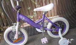 "Here is a Girls USED 12"" BIKE with Training Wheels Old"