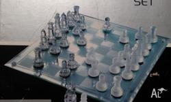 An etched glass Chess Board with solid glass Chess